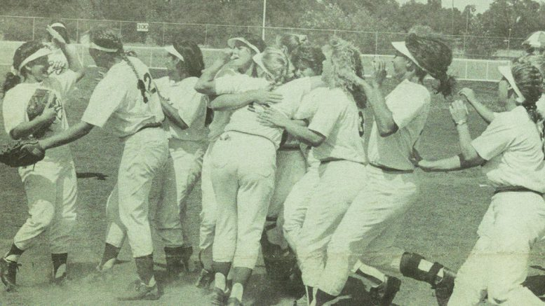 CELEBRATION!—The Panthers' softball team members congratulate each other after defeating Palomar in the state championship playoffs May 17. Exchanging hugs, from left to right, are Deanna Novoa, Stefanie Acton, Miko Kubabara, Amy Windmiller, Becky Burroughs, Beth Gerken, Kim Wright, Trish Geduilas, Christa Sanchez and Laura Merritt.  Photo by Rich Bickel