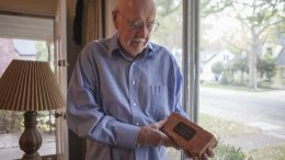 Former City College librarian Jack Halligan in his home, holding a brick from the former Sacramento City College Library that stood from 1937-1996. Vanessa S. Nelson | vanessanelsonexpress@gmail.com