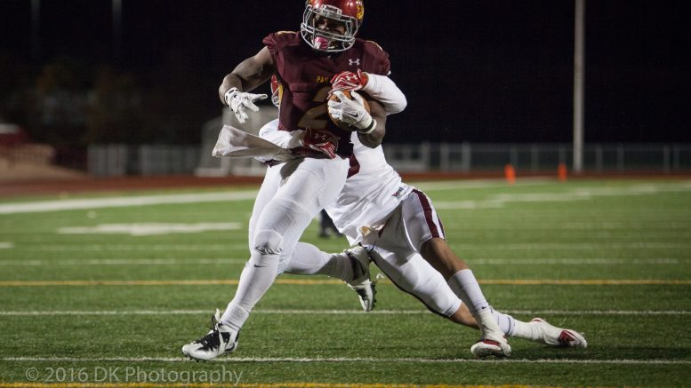 Tyree Hanson, City College sophomore running back scores his second touchdown in the centennial home coming game against Sierra College at Hughes Stadium on Oct. 15th.  ©2016 Dianne Rose
