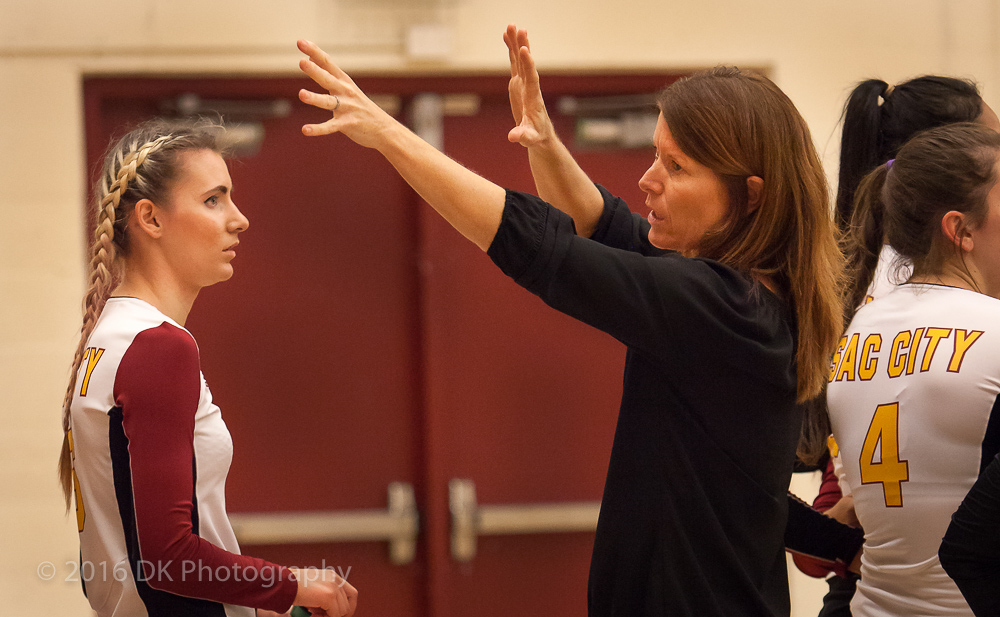 Svetlana Varkentin listens as City College head coach Laurie Nash talks about blocking at the net in the match against Santa Rosa College at North Gym on Sept. 30th. ©2016 Dianne Rose