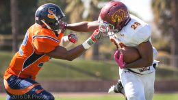 Jimmy Hatch, City College freshman runningback is grabed by his face mask by  Mark Meyniesse of College of Sequoias late in the first quarter at Mineral King Bowl on Oct. 1st.  ©2016 Dianne Rose