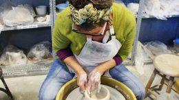 City College student Georgia Graham, art major, throwing a vase on the wheel in Mark Boguski's intermediate wheel throwing class. Nov. 16, 2016. Julie Jorgensen, Staff Photographer. juliejorgensenexpress@gmail.com