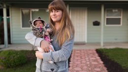 City College student Anita Stupina poses for a photo with her foster child in front of her home in West Sacramento on Nov. 23, 2016. Hector Flores, Staff Photographer. | hectorfloresexpress@gmail.com