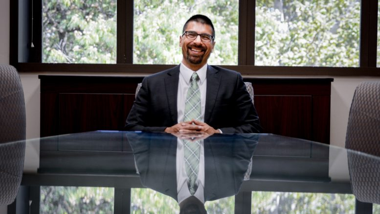 New City College president Michael Gutierrez in a conference room in Rodda Hall North Thursday, Aug. 10. Gutierrez officially took office July 24. Jason Pierce | Photo Editor | jpierce.express@gmail.com