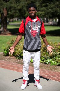 John Huntley, 19, says sports is his passion and his fashion decisions are greatly influenced by it. He pairs his new shoes with his favorite Chicago Bulls jersey. Ulysses Ruiz | Staff Photographer | Uruiz.express@gmail.com