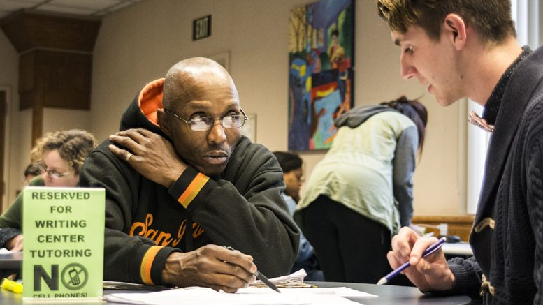 Student Craig White works with tutor Daniel Goring in the Learning Resource Center at City College, where students can get no cost tutoring in a variety of subjects. March, 22, 2017 Jason Pierce | jpierce.express@gmail.com