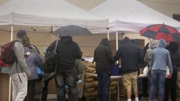 City College students line up in spite of the rain to receive food from the RISE program's food distribution tents. Students who are interested in receiving food from RISE can sign up every Tuesday in the RISE office located in Temp 5 or call (916)-650-2782. Food is distributed Wednesdays from noon to 5p.m.  Sonora Rairdon  Staff Photographer   srairdon.express@gmail.com