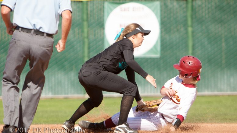Taylor Fratto, City College sophomore infielder is tagged out after trying to steal second on a bad throw to first during the game against Folsom College at the Yard on March 21st © 2017 Dianne Rose