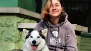 Anastasia Spitzer, 25, Lucky Buddy Pet Care employee and Sacramento City College student with her husky Roman.