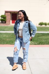 Lexy Nguyen, 19, studies fashion at City College. Nguyen is sporting denim on denim and trendy, reflective sunglasses. Nguyen says Vanessa Hudgens is her style muse and loves Coachella festival inspired outfits. Ulysses Ruiz | Staff Photographer | Uruiz.express@gmail.com