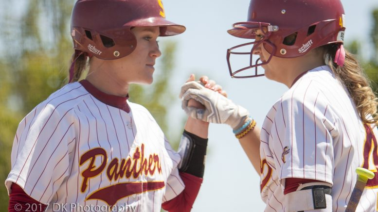 Taylor Fratto (left), City College sophomore infielder gets a high five after scoring from teammate Ashley Adamson in the final home game against Santa Rosa College at the Yard on Apr 21st ©2017 Dianne Rose