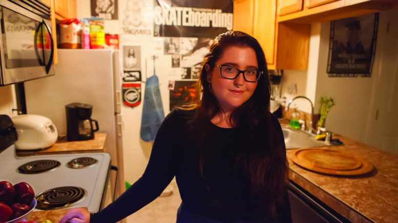 City College student Emily Peterson stands in her midtown Sacramento apartment. Peterson is one of the many local residents struggling with recent rent increases. | Photo by Vanessa S. Nelson · vanessanelsonexpress@gmail.com