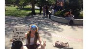 Student Sam Gibbens holds a sign Tuesday in protest of the anti-abortion group Project Truth in the quad.  Heather Roegiers | News Editor |  kroegiers.express@gmail.com