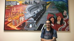 City College student and president of the Creative Alliance Club, Francisco Vasquez, in front of a painting he collaborated on. Jiaxin Lu   Staff Photographer   jlu.express@gmail.com
