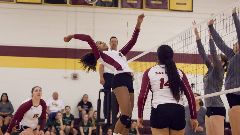 Brittany Honeycutt, City College freshman middle hitter, spikes the ball in the match against De Anza College in the North Gym on Sept. 13. The Panthers lost 3-0 to De Anza, but swept Shasta College 3-0 later that day. ©2017 Dianne Rose