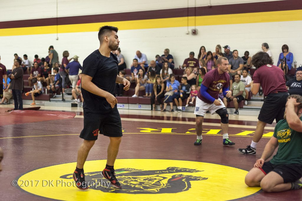 Jorge Landeros, 2016 City College alumnus, warms up for his match Sept. 2 in the North Gym. He wrestled his brother, Tomas Landeros, who is a current freshman on the wrestling team. ©2017 Dianne Rose