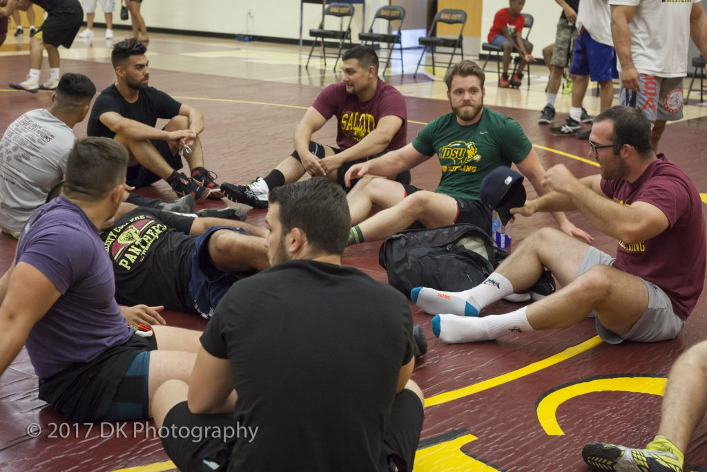 Wrestling alumni wait on the mats prior to their matches with current City College Wrestlers on Sept. 2 in the North Gym. ©2017 Dianne Rose.