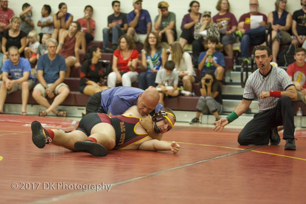 Dustin Silva, City College alumnus, has Robbie Nickerson, City College sophomore in a hold at the alumni matches at the North Gym on Sept. 2. ©2017 Dianne Rose
