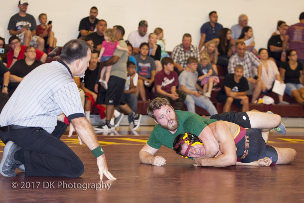 Logan Paxton, City College alumnus, has Luis Ayala, City College freshman in a hold at the alumni matches at the North Gym on Sept. 2. ©2017 Dianne Rose
