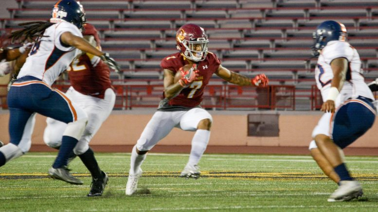 City College wide receiver Jordan Moore (#7) runs the ball Saturday evening early in the 2nd quarter of the game against College of the Sequoias at Hughes Stadium.  Jason Pierce | Photo Editor | jpierce.express@gmail.com