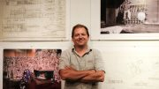 Guest curator Justin Wood standing in front of photos showcasing Carter Sparks' work. Sparks was an architect who designed homes in the Sacramento area. The exhibit is currently on display in the Kondos Gallery. Jiaxin Lu   Staff Photographer   jlu.express@gmail.com