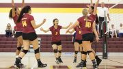City College Volleyball team celebrates after winning the point in the first game of the match against Simpson University JV in the North Gym on Sept. 9th. ©2017 Dianne Rose