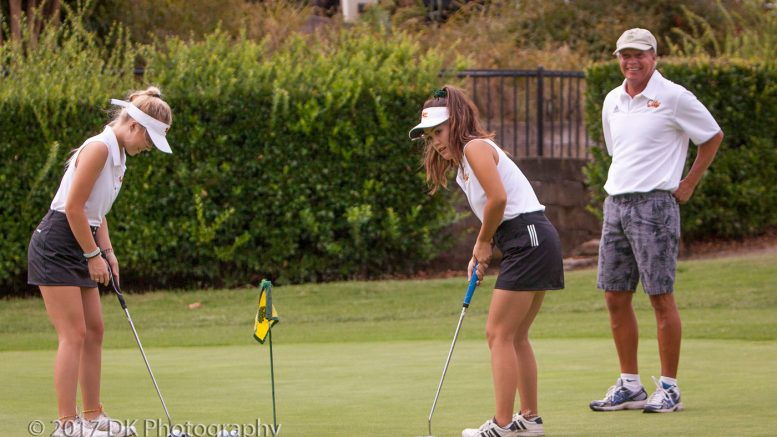 City College assistant coach John Hoag watches as sophomore sisters Hunter (left) and Ciera Hoag (right) practice putting before the Big 8 match at Whitney Oaks Golf Course on Sept. 7th. ©2017 Dianne Rose