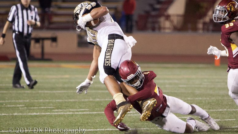 Christian McFarland, City College sophomore defensive back, makes the tackle on Butte College's Juan Rodriquez and saves the possible touchdown in the fourth quarter at Hughes Stadium on Nov. 11. ©2017 Dianne Rose