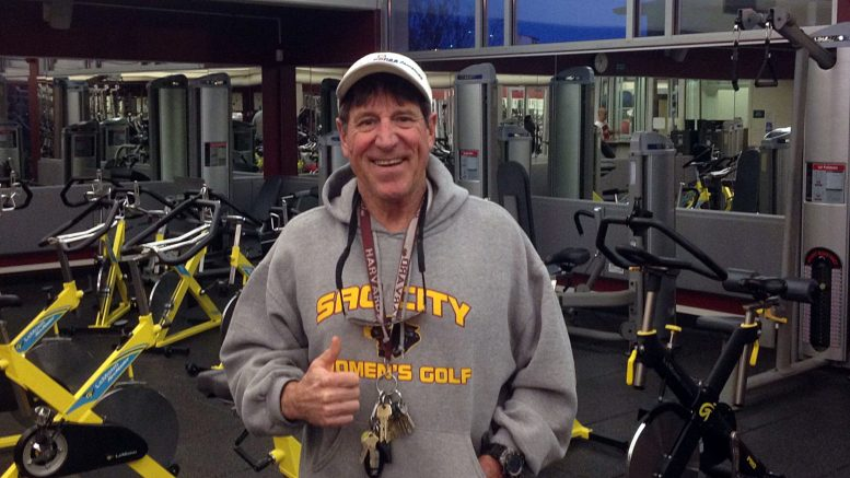 Mark Areson supervises the Life Fitness Center on campus Dec. 7. Photo by Heather Roegiers.