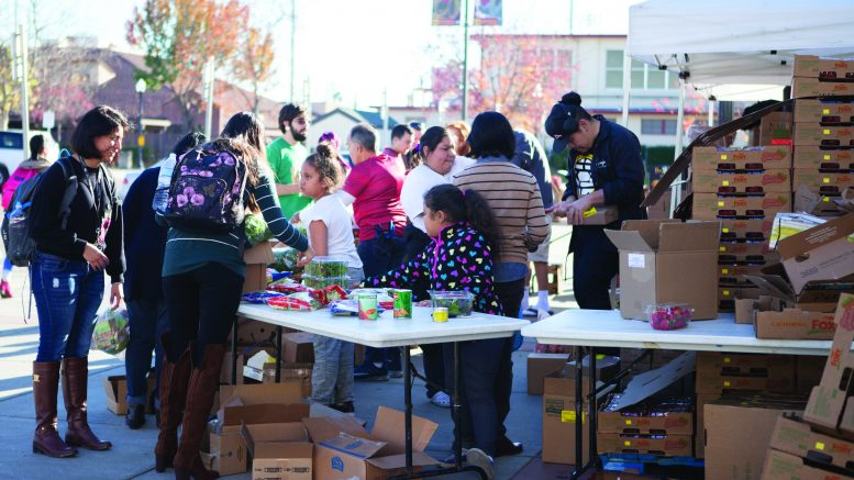 The RISE food distribution near the College Store operates at full tilt Nov. 29. Some of the nonperishable food items handed out came from Phi Theta Kappa's food drive. Photo by Vanessa S. Nelson | vanessanelson.express@gmail.com