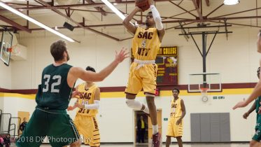"""Raphael """"Cinco"""" Durr, City College sophomore guard takes a jump shot in the second half of the game against Diablo Valley in the North Gym on Jan. 11th. ©2018 Dianne Rose"""