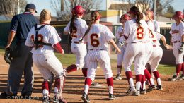 City College freshman Elizabeth Caffero is greeted by her teammates at home plate after crushing her third home run of the game, a walk-off grand slam,  against Lassen College Feb. 14 at The Yard. | Photo by Dianne Rose |  dianne.rose.express@gmail.com