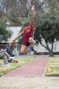 City freshman Aaliyah Saunders leaps for distance during the long jump March 10 at the UC Davis Aggie Open. Saunders placed 12th overall with a jump of 4.14 meters.   Photo by Jason Pierce   jpierce.express@gmail.com